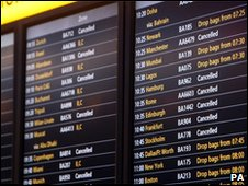 Departures board at Heathrow showing snow-related delays and cancellations