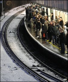 Passengers crowd a train platform