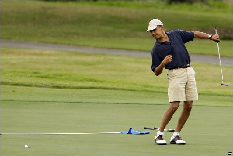 Barack Obama playing golf in Hawaii