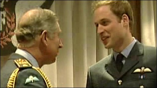 Prince William receiving his badge from Prince Charles