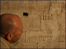 Conservator Tom Beattie studies the text