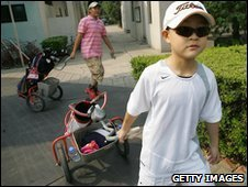 Young golfers head to the greens for their lesson at a Beijing golf course.