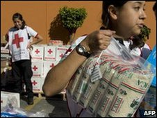 Red Cross workers in Mexico prepare aid for Haiti earthquake victims