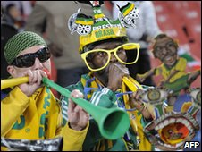 Football fans playing the vuvuzela