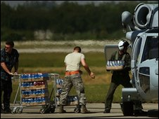 US soldiers load a helicopter with water at the international airport in Port-au-Prince, Haiti, 15 January 2010
