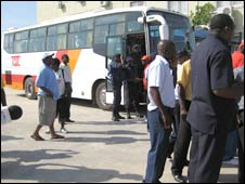Malawi players wait on bus