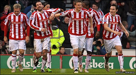 Stoke players celebrate Huth's last-gasp equaliser