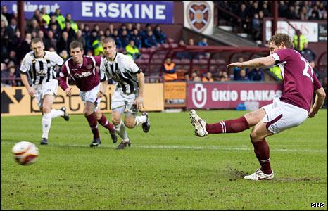 Hearts midfielder Michael Stewarts scores a penalty