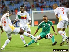 Nigeria's Osaze Odemwingie (in the middle) with three Benin players
