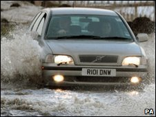 A car on a flooded road in Scotland