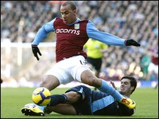 Gabriel Agbonlahor tackled by James Tomkins