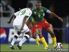 Samuel Eto'o (right) takes on Zambia's Thomas Nyirenda