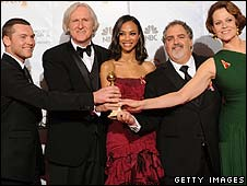 Avatar director James Cameron (second left) celebrates with his cast and co-producer (second from right)