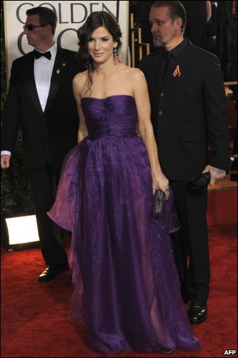 US actress Sandra Bullock and her husband Jesse James arrives for the 67th Golden Globe Awards