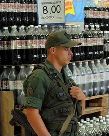 Venezuelan National Guard member standing in a supermarket aisle in Caracas on 11 January, 2010