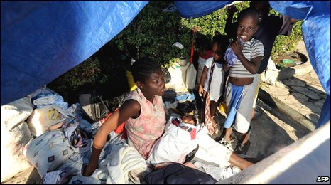 A family takes shelter in a makeshift tent in Port-au-Prince, 16 January