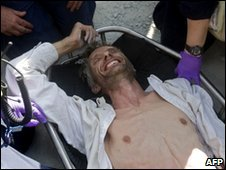 Jens Kristensen smiles after being rescued from the rubble of UN headquarters after five days