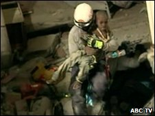 The moment Nazer Erne emerged in the arms of a rescuer (ABC TV)