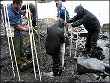 Scientists installing sampling equipment (Image: NRDP)