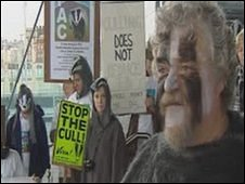 A protester dressed as a badger 