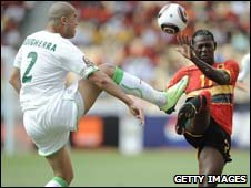 Algeria's Madjid Bougherra and Angola's Ze Kalanga battle for the ball