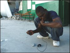 Man tires to fix mobile phone