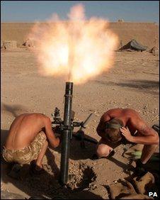 Soldiers firing a mortar in Afghanistan