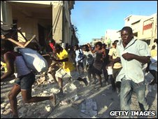 People running away from police in Port-au-Prince 18 Jan