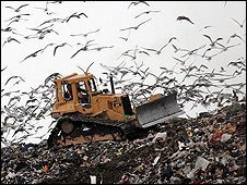 A bulldozer working at a landfill site