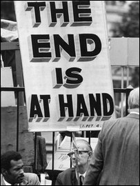 Sandwich board stating The End is at Hand