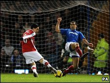 Arsenal's Samir Nasri scores against Portsmouth