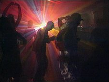 Clubbers in a rave