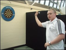 A student darts player