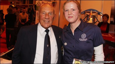 Alice Powell receives her award from Sir Stirling Moss