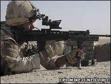 British soldier uses the new Advanced Combat Optical Sight