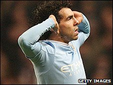 Carlos Tevez celebrates against Manchester United
