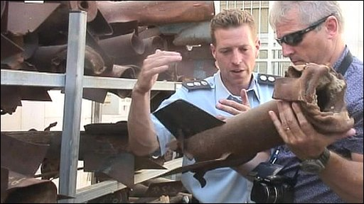 A policeman showing Tim Collins fired rockets