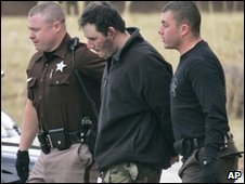 Suspected gunman Christopher Speight (centre) is led out of police HQ in Appomattox, 20 January