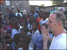 Bill Drummond with children in Haiti