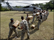 US soldiers unload aid from a helicopter