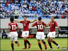 Egypt players celebrate Emad Moteab's first goal