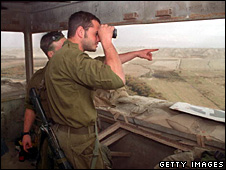 Israeli troops look out over the Jordan Valley (2001)