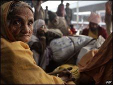 Passengers wait at a railway station in Delhi on Wednesday, Jan 20, 2010 as their trains are delayed by fog