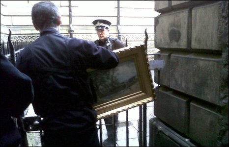 Police removing the painting from railings