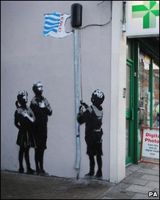Banksy image on a chemist wall in London