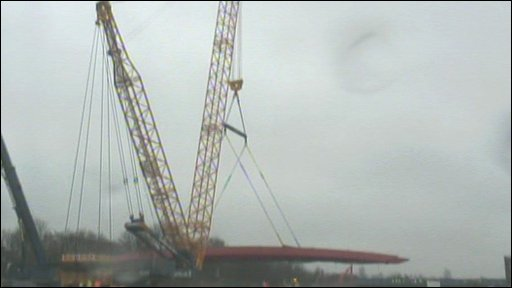 Bridge being lifted by crane