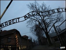 File photo of Arbeit macht frei sign at entrance to Auschwitz