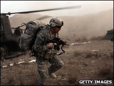 US army officer during exit a helicopter during an air assault operation on the town of Oshaky  in Afghanistan