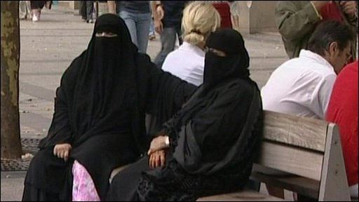 Two women wearing full veils or burqas