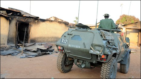 Soldiers in armoured tank patrol an area following violent clash at Kuru Karama, 30 kilometres from Jos Township, Plateau State on January 21, 2010.
